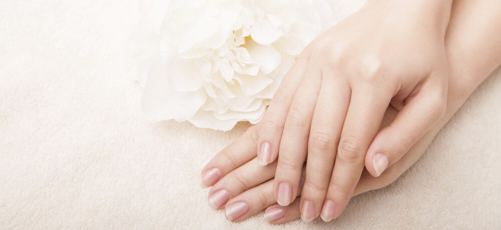 Beautiful hand with perfect nail manicure
